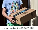 Small photo of WASHINGTON DC, USA - JUNE 08, 2017: An Amazon Prime package delivered to a residential home.