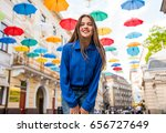 beautiful girl walking under... | Shutterstock . vector #656727649