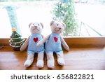 two teddy bear sitting on a... | Shutterstock . vector #656822821