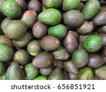 Small photo of Tray of fresh avocado (Persea americana), also alligator pear, tree's fruits native to South Central Mexico, Lauraceae family which is botanically a large berry containing a single seed