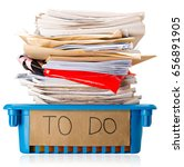 Small photo of Procrastination - A full To Do tray - Overwhelmed - Isolated on white background