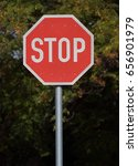 Small photo of Stop sign post