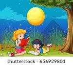 two girls reading book on... | Shutterstock .eps vector #656929801
