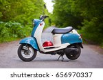 Blue Retro Scooter In The...