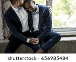 gay couple in navy blue tuxedo... | Shutterstock . vector #656985484