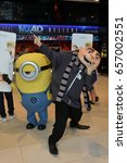 Small photo of Bangkok, Thailand - June 10, 2017: Minions MEL Mascot and Felonious Gru Mascot from Movie Despicable Me 3 at the theater