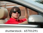 young man driving a convertible. | Shutterstock . vector #65701291