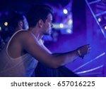 man sitting alone watching live ... | Shutterstock . vector #657016225