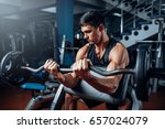 tanned man exercise with... | Shutterstock . vector #657024079
