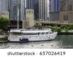 Small photo of CHICAGO, ILLINOIS/USA - JUNE 8, 2017: Passengers debark a charter tour boat along the Chicago River after a skyline cruise along the urban shoreline of Lake Michigan.