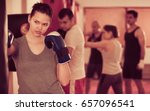 sports girl  beating boxing bag ... | Shutterstock . vector #657096541