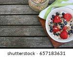 healthy breakfast bowl. granola ... | Shutterstock . vector #657183631