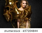 beautiful blonde woman on black ...   Shutterstock . vector #657204844
