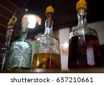 Small photo of Traditional ukrainian GORILKA alcoholic drink in bottles plugged by corncob