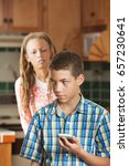 teenaged son holds cell phone... | Shutterstock . vector #657230641