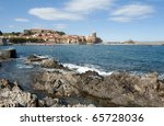 The harbour, with the Royal castle and the church called the Notre Dame des Anges at Collioure in the South of France - stock photo
