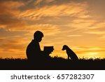 Silhouette Boy Reading A Book...