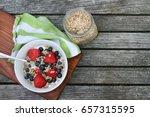 healthy breakfast bowl. granola ... | Shutterstock . vector #657315595