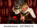 old funny king getting drunk... | Shutterstock . vector #657340174
