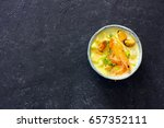 Small photo of Soup with seafood, potatoes and cream over black atone background. Top view. Copy space