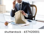 guy in suit is sitting at table ... | Shutterstock . vector #657420001