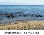 Rocks On Sandy Shore Beach...