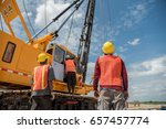 engineer and foreman looking at ...   Shutterstock . vector #657457774