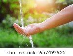 water pouring splash in hand... | Shutterstock . vector #657492925