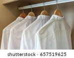 men's shirts on hangers in... | Shutterstock . vector #657519625