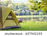 Camping Tent In Forest Near Lake