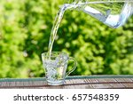 pour water from pitcher into... | Shutterstock . vector #657548359