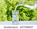 drinking water is poured from... | Shutterstock . vector #657548437