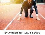 business man preparing to run...