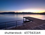 sunset over winter lake  | Shutterstock . vector #657563164