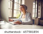 smiling female freelancer with... | Shutterstock . vector #657581854