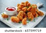 fried crispy chicken nuggets... | Shutterstock . vector #657599719