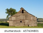 Dilapidated Wooden Barn With...