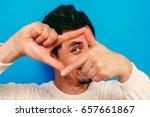 man making a hand frame   Shutterstock . vector #657661867