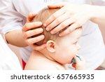 seven month baby girl's head... | Shutterstock . vector #657665935