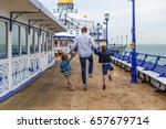 Family On Eastbourne Pier In...