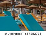 Sun Beds And Wicker Parasols A...