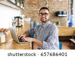 happy man working on laptop.... | Shutterstock . vector #657686401