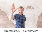 young man making high five... | Shutterstock . vector #657689989