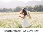 Woman Enjoying A Field Of...