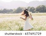 Woman Enjoying A Field Of...