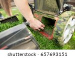 young man hands cleaning mower... | Shutterstock . vector #657693151