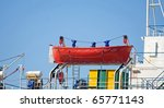 Lifeboat on tanker, blue sky - stock photo