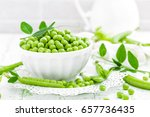 Green Peas With Leaves On Whit...