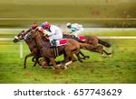 Stock photo race horses with jockeys on the home straight shaving effect 657743629