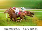 Stock photo race horses with jockeys on the home straight shaving effect 657743641